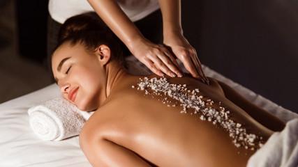 Salt Scrub Massage. Woman Relaxing In Health Spa