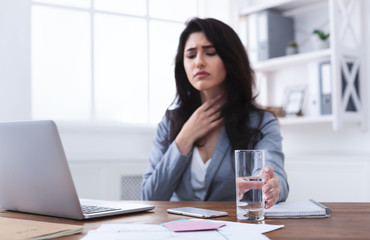 Sick Businesswoman With Sore Throat Trying To Work