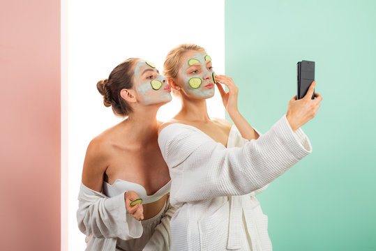 Taking selfie. Anti age care. Skin care for all ages. Women having fun skin mask. Pure beauty. Beauty product. Spa and beauty care. Girls friends sisters in bathrobes making clay facial mask