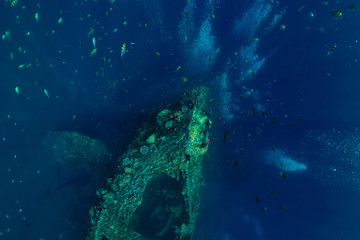 Beautiful underwater view with bubbles at wreck ship