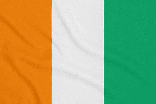 Flag of Cote d'Ivoire on textured fabric. Patriotic symbol