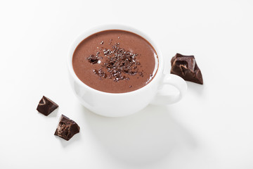 Poster Chocolade Hot chocolate drinks and chocolate pieces in white cup.