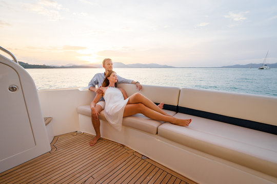 Loving couple on the yacht.