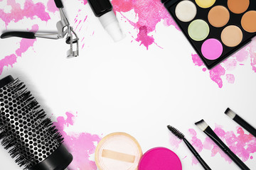 Glamour still life photo of cosmetics on pink watercolor hand drawn backdrop. Woman's make up table. Graphic template mock up.