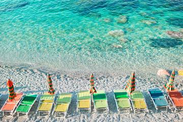 Empty beach with closed umbrellas on italian coast Wall mural