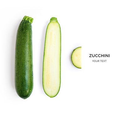 Creative layout made of green zucchini Flat lay. Food concept.