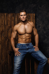Portrait of handsome muscular and sexy man wearing jeans