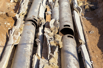 Old pipes with asbestos insulation