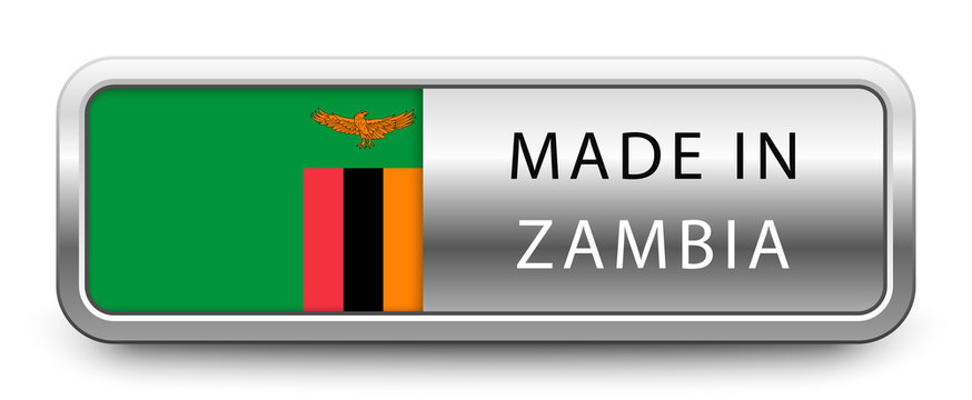 MADE IN ZAMBIA metallic badge with national flag isolated on white background