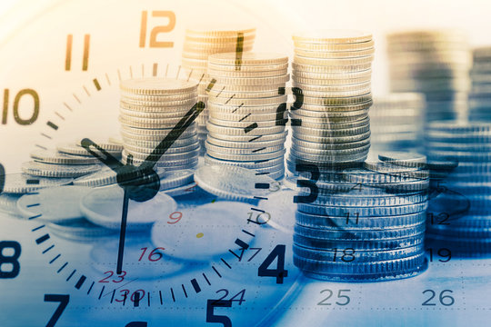 double exposure of rows of coins and calendar with clock for business and finance background
