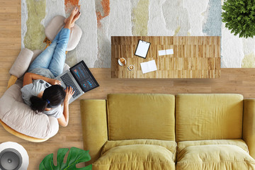 Woman working from home from living room
