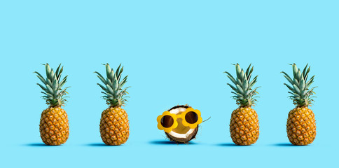 One out unique coconut wearing sunglasses with many pineapples Fotoväggar