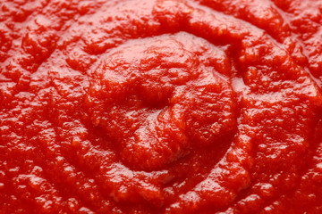 Homemade tomato Passata sauce closeup, background, texture.