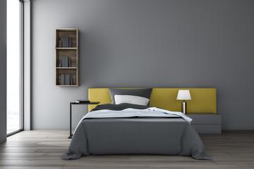 Gray bedroom interior with bookshelves