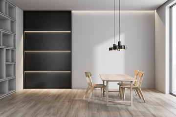 White loft dining room with bookcase