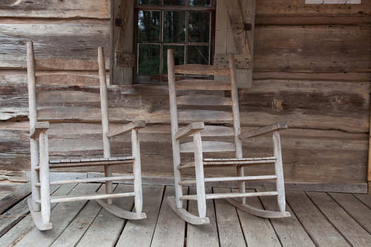 Rocking chairs on a front porch of a cabin