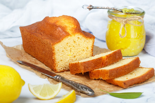 Homemade pound cake with lemon and jam. Traditional treat for tea. Citrus loaf cake. Selective focus