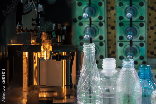 The abstract scene of preform shape of plastic bottles and