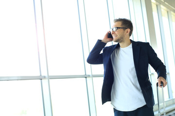 Businessman on the phone at the airport