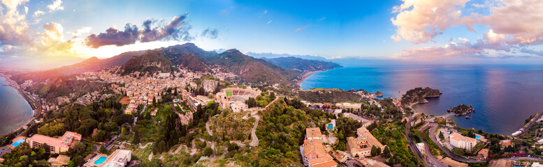 Taormina, Sicily Italy panoramic drone photo sunset, volcano Etna in clouds. Aerial top view Fototapete