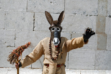 """A member of the """"Carnaval del Toro de Morales de Valverde"""" folk group poses for a photo before the parade of the 14th International Festival of the Iberian Mask in Lisbon"""