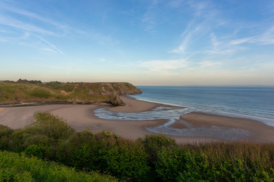 View of 3 cliffs Bay at sunset, Wales