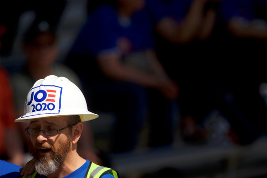 "A supporter wears a construction hard hat reading ""JOE 2020"" during a campaign rally for Democratic 2020 U.S. presidential candidate and former Vice President Joe Biden in Philadelphia"