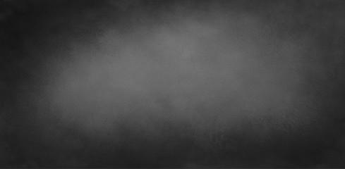 Black background with texture. Old vintage chalkboard illustration with dark black border and light gray center. Elegant website header or banner.
