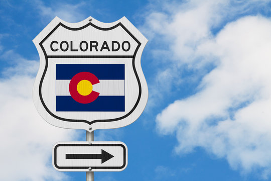 Colorado map and state flag on a USA highway road sign