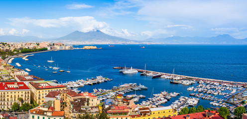 Fotobehang Napels Naples city and port with Mount Vesuvius on the horizon seen from the hills of Posilipo. SSeaside landscape of the city harbor and golf on the Tyrrhenian Sea