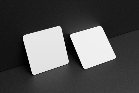 3D render Mock-up of the two square business cards are on a black paper