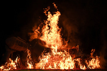 Fire burning a Buddha statue is seen during a ceremony on Vesak Day in Mojokerto, East Java province