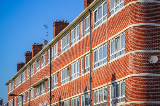 A red brick block of council flat in London