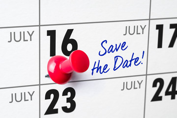 Wall calendar with a red pin - July 16