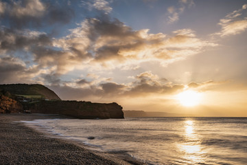 Wall Murals Cappuccino Stunning sunrise landscape image of Ladram Bay beach in Devon England with beautiful rock stacks on beach