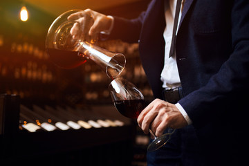 provide excellent wine service,presentation of the wine and pouring. close up cropped photo