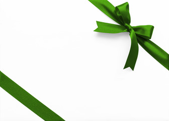 Green bow satin ribbon band stripe fabric emerald jade color on corner (isolated on white...