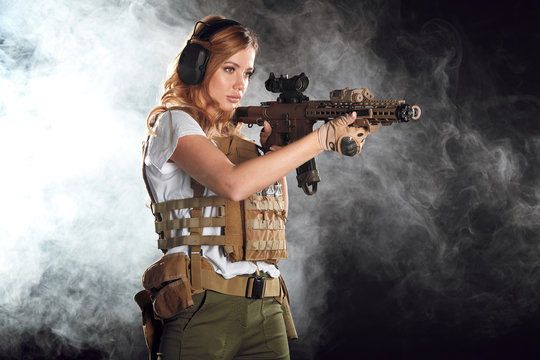 woman sniper with SVD sniper rifle. Female in US Army soldier with rifle. Shot in studio.