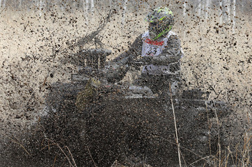 "Rider competes during the ""Kings of the Off-road"" amateur quad bike race in a Siberian boggy area in Krasnoyarsk region"