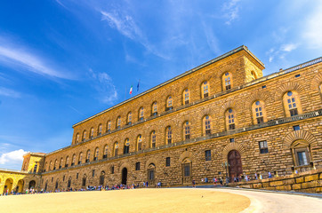 Facade of Palazzo Pitti palace with Gallery of Modern Art large building on Piazza dei Pitti square in historical centre of Florence city, blue sky white clouds, Tuscany, Italy Fototapete