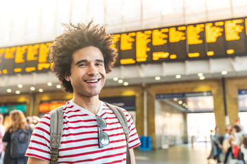 Happy man portrait at train station in London
