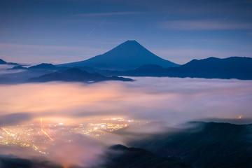 Mt.Fuji and sea of mist at night seen from Mt.Kushikata view point