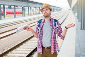 Portrait of caucasian male in railway train station