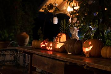 Jackolantern pumpkins at night