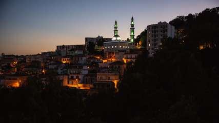 A mosque on a hill at night in Casbah, Algiers, Algeria