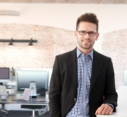 Successful young businessman at office
