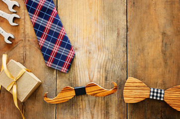 Canvas Prints Countryside Father's day concept. gift box, tie and funny moustache over wooden background. top view, flat lay