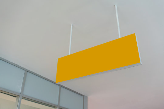 Blank yellow advertising ceiling Promotional Advertising dangler for design presentation