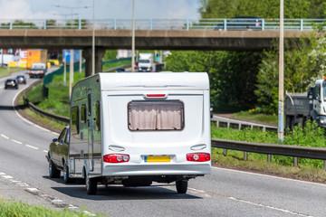 Fototapeta caravan motorhome on uk motorway in fast motion obraz