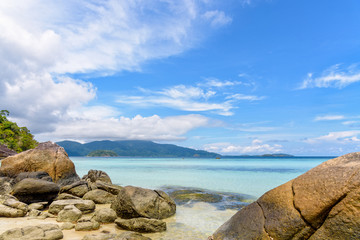 Fototapeta Beautiful tropics nature landscape of clear sea, beach, rocks and clouds on blue sky in the summer at Ko Ra Wi, See the Ko Adang in front near Koh Lipe island Tarutao National Park, Thailand obraz